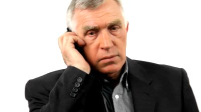stock-footage-businessman-talking-on-his-mobile-phone-isolated-on-white-background